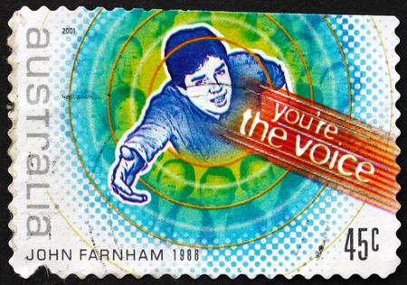pop singer: AUSTRALIA - CIRCA 2001: a stamp printed in Australia shows Youre the Voice, by John Farnham, Australian Pop Singer, Rock Music, circa 2001 Editorial