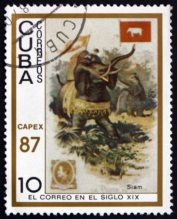 messengers: CUBA - CIRCA 1987: a stamp printed in Cuba shows Messengers Ridding Elephants, Thailand, 19th Century Mail Carrier Pictured on Cigarette Card, circa 1987