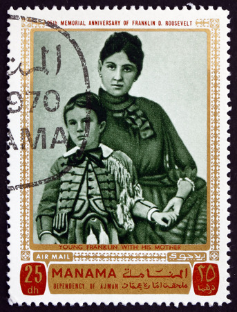 MANAMA - CIRCA 1970: a stamp printed in Manama shows the Young Franklin Delano Roosevelt with his Mother, circa 1970