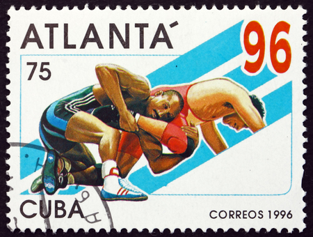 olympics: CUBA - CIRCA 1996: a stamp printed in Cuba shows Wrestling, 1996 Summer Olympics, Atlanta, circa 1996 Editorial
