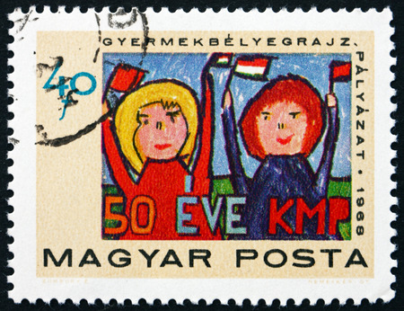 pioneers: HUNGARY - CIRCA 1968: a stamp printed in Hungary shows Pioneers Saluting Communist Party, Childrens Painting, 50th Anniversary of the Communist Party of Hungary, circa 1968