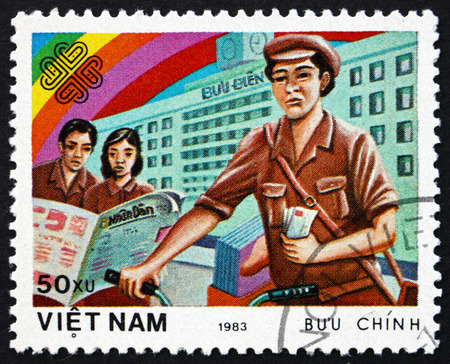 perforated: VIETNAM - CIRCA 1983: a stamp printed in Vietnam shows Letter Carrier, World Communications Year, circa 1983