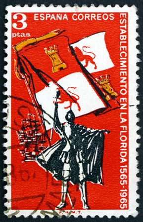 SPAIN - CIRCA 1965: a stamp printed in Spain shows Explorer, Royal Flag of Spain and Ships, 400th Anniversary of the Settlement of Florida, circa 1965