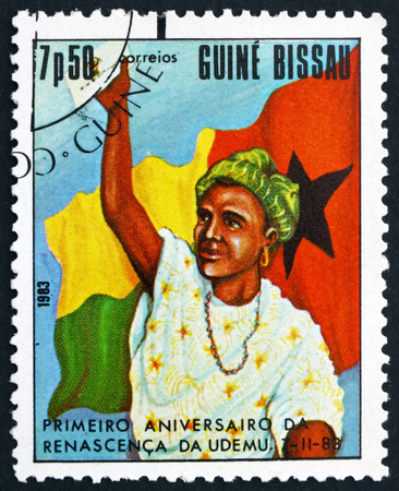 women's issues: GUINEA-BISSAU - CIRCA 1983: a stamp printed in Guinea-Bissau shows Woman and Flag, First Anniversary of Womens Federation, circa 1983 Editorial