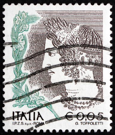etruscan: ITALY - CIRCA 2002: a stamp printed in the Italy shows Young Velca, Etruscan Tomb, circa 2002 Editorial