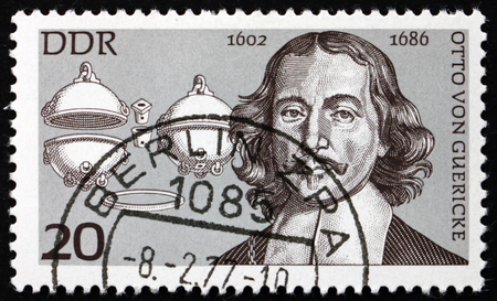 physicist: GERMANY - CIRCA 1977: a stamp printed in Germany shows Otto von Guericke, Physicist, and Magdeburg Hemispheres, circa 1977