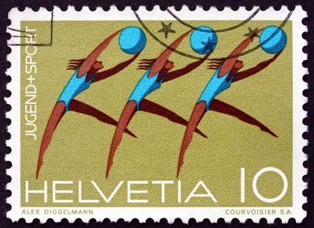 trio: SWITZERLAND - CIRCA 1971: a stamp printed in Switzerland shows Gymnastic Trio, New Article on Gymnastics and Sports in Swiss Constitution, circa 1971