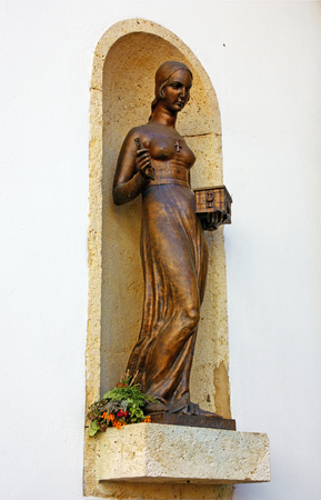 Statue of Dora Krupic, a character from the novel Goldsmiths Gold (1871) by August Senoa, placed in a niche on the western front of the Stone Gate, Zagreb Editorial