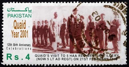 jinnah: PAKISTAN - CIRCA 2001: a stamp printed in Pakistan shows Mohammed Ali Jinnah Reviewing Troops, Quaid Year, circa 2001