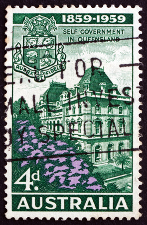 centenary: AUSTRALIA - CIRCA 1959: a stamp printed in Australia shows Parliament House, Brisbane, and Queensland Arms, Centenary of Queensland Self-government, circa 1959