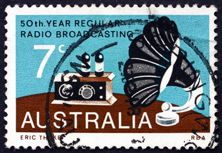 AUSTRALIA - CIRCA 1973: a stamp printed in Australia shows Radio and Gramophone Speaker, Broadcasting in Australia, 50th Anniversary, circa 1973