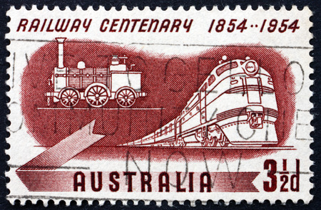 centenary: AUSTRALIA - CIRCA 1954: a stamp printed in Australia shows Diesel and Early Steam Locomotives, Centenary of Australian Railroads, circa 1954