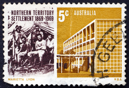 AUSTRALIA - CIRCA 1969: a stamp printed in Australia shows Surveyor George W. Goyder and Assistants, 1869; Building in Darwin, 1969, circa 1969 Editorial