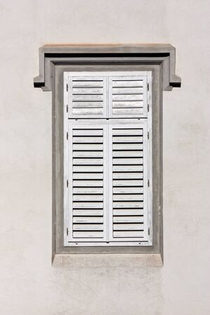 security shutters: Closed green wooden window shutters, security element