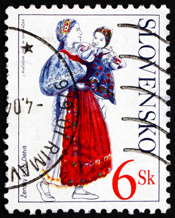 SLOVAKIA - CIRCA 2001: a stamp printed in Slovakia shows Woman and Child from Detva, Traditional Costume, circa 2001