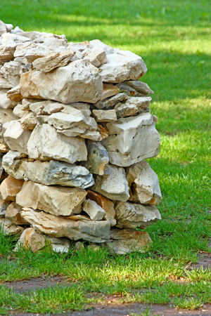 Drywall, wall built up with natural stones in the meadow Stock Photo