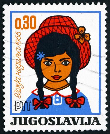 YUGOSLAVIA - CIRCA 1966: a stamp printed in Yugoslavia shows Girl, Children�s Week, circa 1966 Editorial