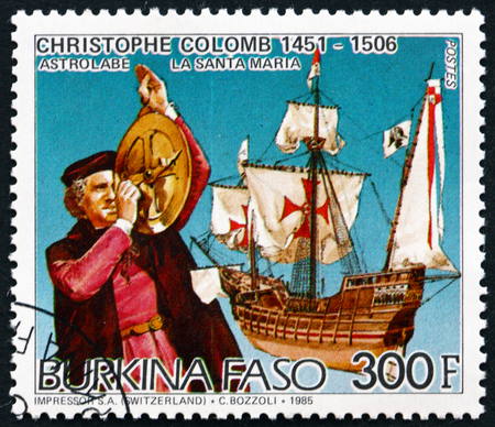 colonizer: BURKINA FASO - CIRCA 1986: a stamp printed in Burkina Faso shows Christopher Columbus, Using Astrolabe, and the Santa Maria, circa 1986 Editorial