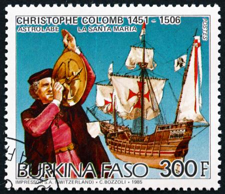 BURKINA FASO - CIRCA 1986: a stamp printed in Burkina Faso shows Christopher Columbus, Using Astrolabe, and the Santa Maria, circa 1986 Editorial