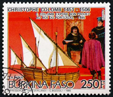 BURKINA FASO - CIRCA 1986: a stamp printed in Burkina Faso shows Christopher Columbus, at Court of King of Portugal, and the Nina, circa 1986