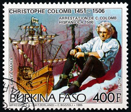 colonizer: BURKINA FASO - CIRCA 1986: a stamp printed in Burkina Faso shows Christopher Columbus, Imprisonment at Hispaniola, and the Santa Maria, circa 1986