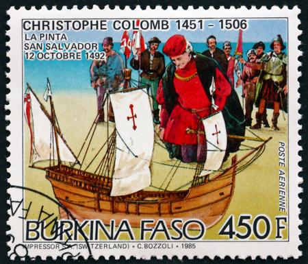 colonizer: BURKINA FASO - CIRCA 1986: a stamp printed in Burkina Faso shows Christopher Columbus, at San Salvador, and the Pinta, circa 1986