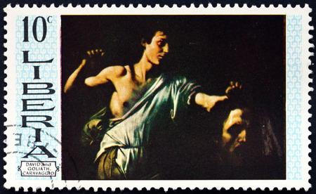 LIBERIA - CIRCA 19669: a stamp printed in Liberia shows David and Goliath, Painting by Carvaggio, circa 1969