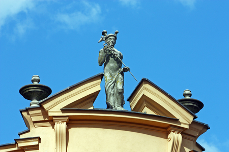 Statue of Mercury, the Roman god of commerce, located on the roof of the first Croatian Savings Bank, Virovitica, Croatia