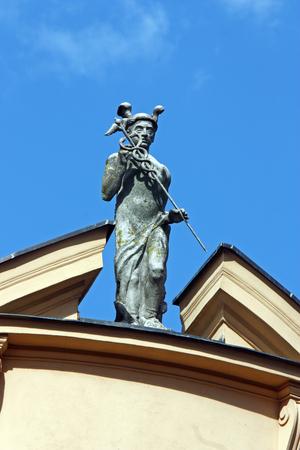 old mercury: Statue of Mercury, the Roman god of commerce, located on the roof of the first Croatian Savings Bank, Virovitica, Croatia