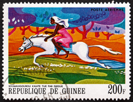 GUINEA - CIRCA 1968: a stamp printed in Guinea shows Soumangourou Kante Killed by Djegue (Woman on Horseback), African Legends, circa 1968