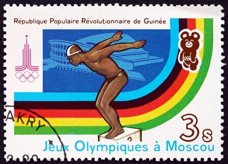 olympic games: GUINEA - CIRCA 1982: a stamp printed in Guinea shows Diving, 22nd Summer Olympic Games, Moscow, circa 1982