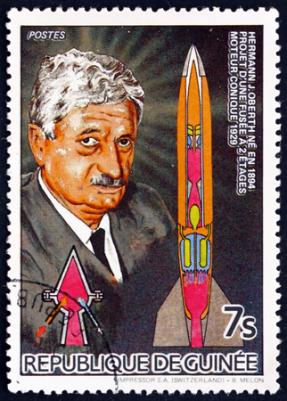 physicist: GUINEA - CIRCA 1985: a stamp printed in Guinea shows Scientist Hermann J. Oberth, German Physicist and Engineer, and Two-stage Rocket, circa 1985 Editorial