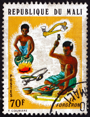 MALI - CIRCA 1974: a stamp printed in Mali shows Smiths, Artisans of Mali, circa 1974