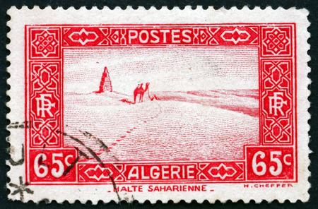 ALGERIA - CIRCA 1937: a stamp printed in Algeria shows Travel across the Sahara, circa 1937