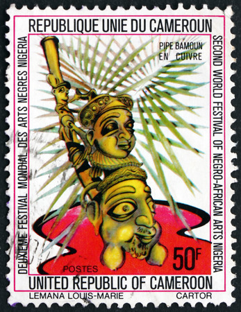 postage: CAMEROON - CIRCA 1977: a stamp printed in Cameroon shows Bamoun copper pipe, 2nd world black and African festival, Lagos, Nigeria, circa 1977