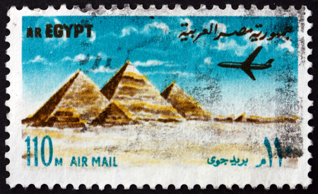EGYPT - CIRCA 1972: a stamp printed in Egypt shows Airplane over Giza pyramids, circa 1972