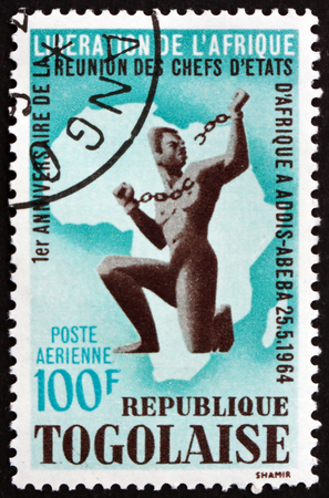 TOGO - CIRCA 1964: a stamp printed in Togo shows African breaking slavery chain, and map, circa 1964