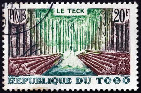 commemorate: TOGO - CIRCA 1957: a stamp printed in Togo shows Teak Forest, circa 1957 Editorial