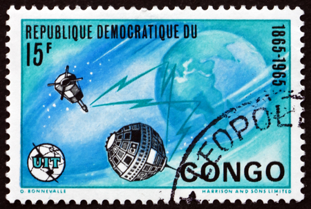 CONGO - CIRCA 1965: a stamp printed in Congo shows Earth and Satellites, circa 1965