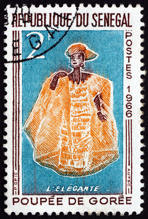 mannequin africain: SENEGAL - CIRCA 1966: a stamp printed in Senegal shows Elegant Woman, Doll of Goree, circa 1966