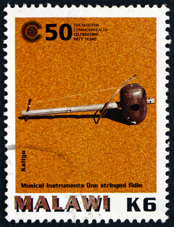 philately: MALAWI - CIRCA 2000: a stamp printed in Malawi shows Kaligo, African Musical Instrument, circa 2000