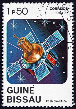 GUINEA-BISSAU - CIRCA 1983: a stamp printed in Guinea-Bissau shows Telecommunications Satellite, circa 1983 Editorial