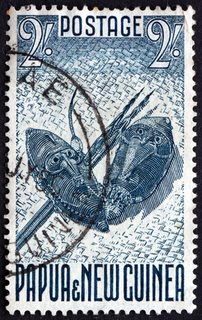 philately: PAPUA NEW GUINEA - CIRCA 1952: a stamp printed in the Papua New Guinea shows Shields and Spears, circa 1952