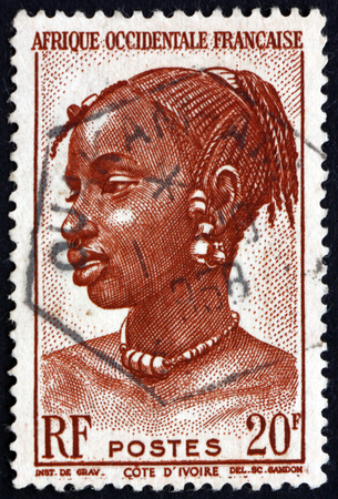 indigene: FRENCH WEST AFRICA - CIRCA 1947: a stamp printed in the France shows Agni Woman, Ivory Coast, circa 1947