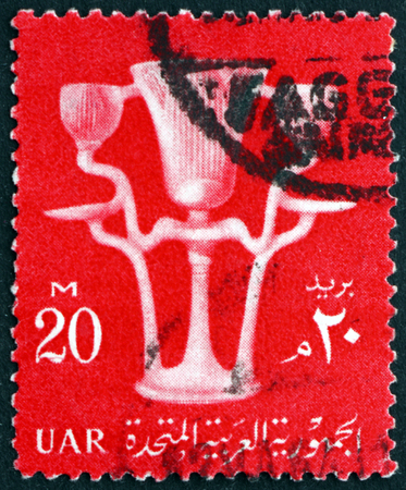 EGYPT - CIRCA 1960: a stamp printed in Egypt shows Lotus Vase, Tutankhamen treasure, circa 1960 Editorial
