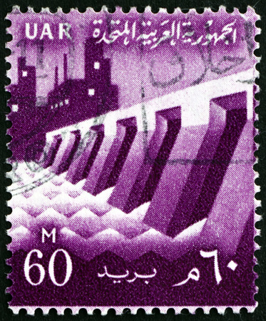 antique factory: EGYPT - CIRCA 1959: a stamp printed in Egypt shows Dam and Factory, circa 1959
