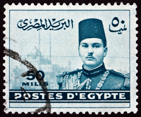 farouk: EGYPT - CIRCA 1939: a stamp printed in Egypt shows King Farouk and Cairo Citadel, circa 1939