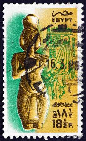 philately: EGYPT - CIRCA 1985: a stamp printed in Egypt shows Statue of Akhenaten (Amenophis IV), Theben, circa 1985