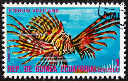 EQUATORIAL GUINEA - CIRCA 1975: a stamp printed in Equatorial Guinea shows Red Lionfish, Pterois Volitans, Tropical Fish, circa 1975
