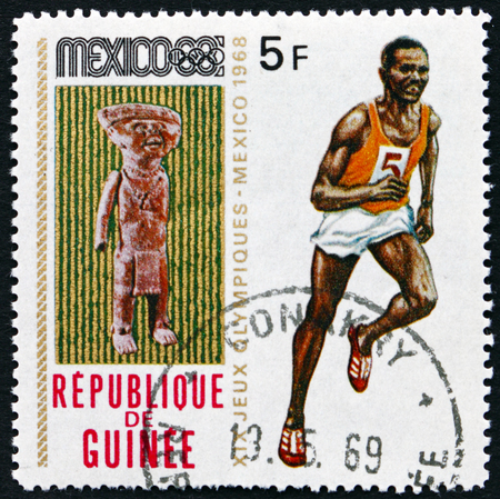 GUINEA - CIRCA 1969: a stamp printed in Guinea shows Sculpture and Runner, 19th Olympic Games, Mexico City, circa 1969